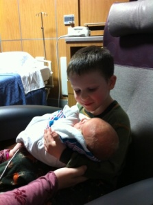 Josiah getting to see and hold Samuel for the first time...he was VERY excited.