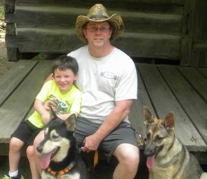 Josiah and my Dad and the dogs, Clara and Maggie.
