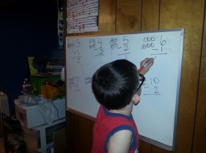 Josiah practicing subtraction.