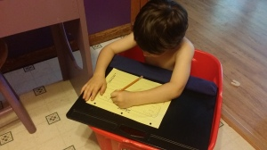 Josiah doing school in a tote bucket. Why? I don't know, he thought it'd be fun. As long as their learning, right?